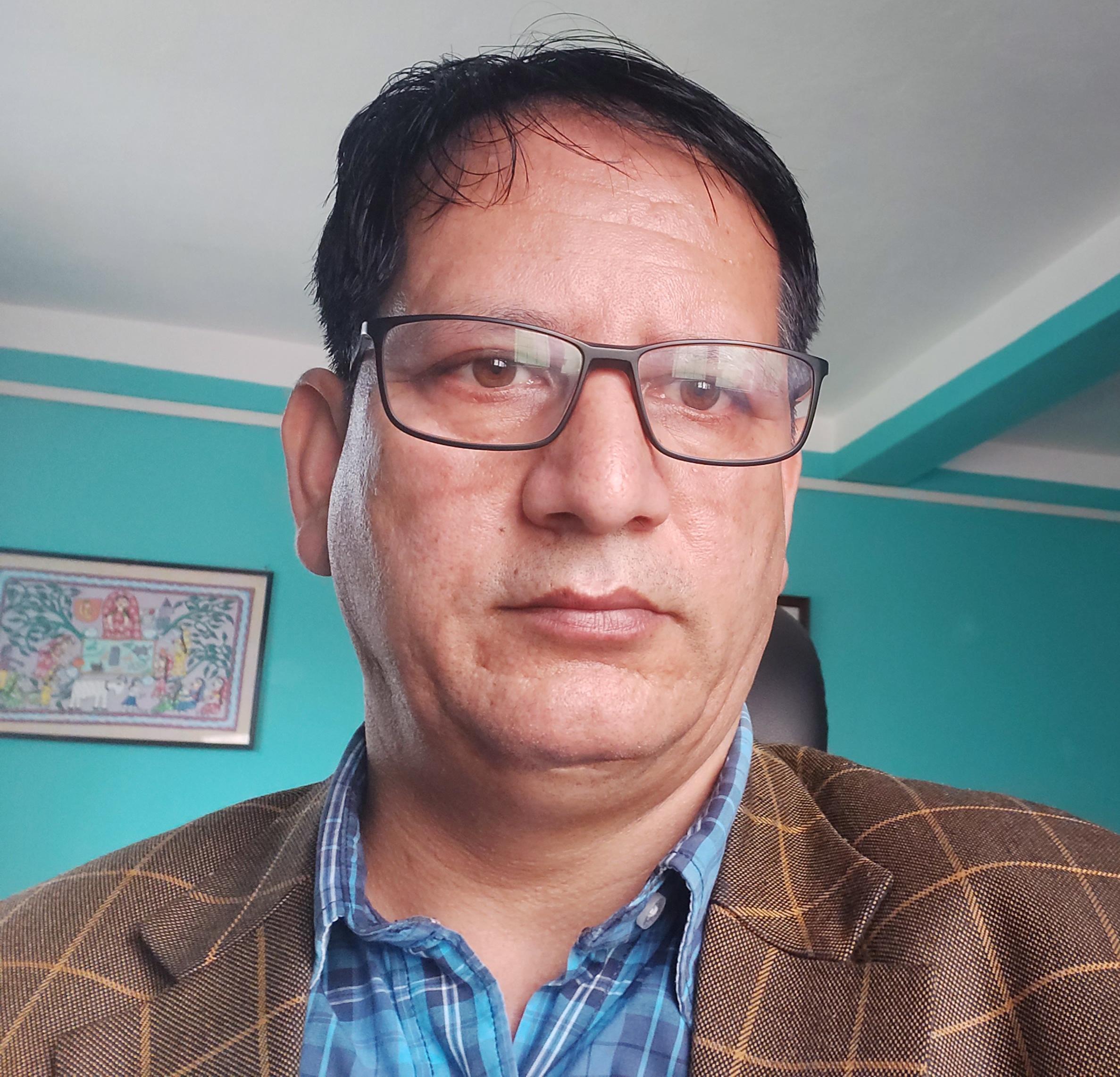 Mr. Ishwori Bahadur Adhikari